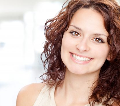 woman with brown hair and nice smile Arvada Dental Center